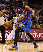 Tony Parker of the San Antonio Spurs tries to dribble past Serge Ibaka of the Oklahoma City Thunder in the second quarter during Game Five of the...
