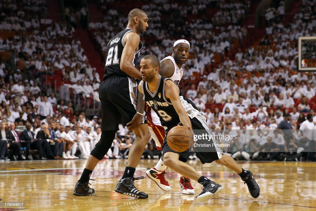 Tony Parker #9 of the San Antonio Spurs uses a screen from Tim Duncan #21 to get around LeBron James #6 of the Miami Heat in the third quarter during Game Two of the 2013 NBA Finals at AmericanAirlines Arena on June 9, 2013 in Miami, Florida.