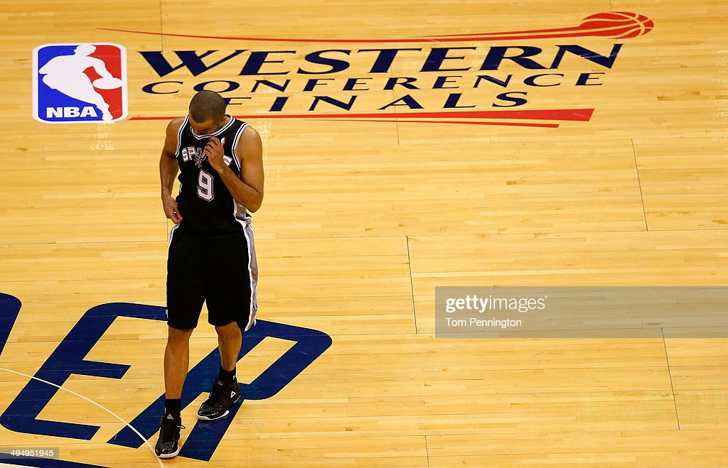 Tony Parker of the San Antonio Spurs walks across the court in the first half of the game against the Oklahoma City Thunder during Game Six of the...