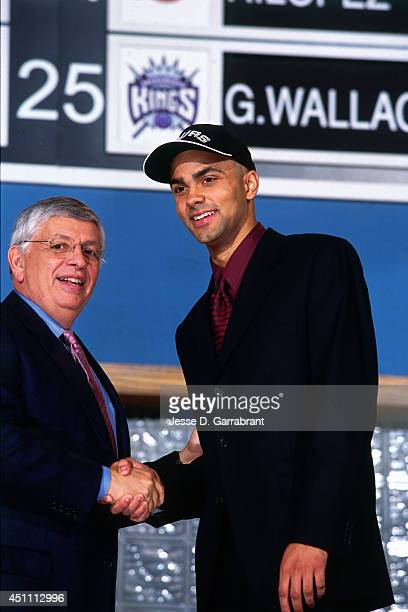 Tony Parker poses with David Stern after being drafted by the San Antonio Spurs on June 27 2001 at The Theater at Madison Square Garden in New York...