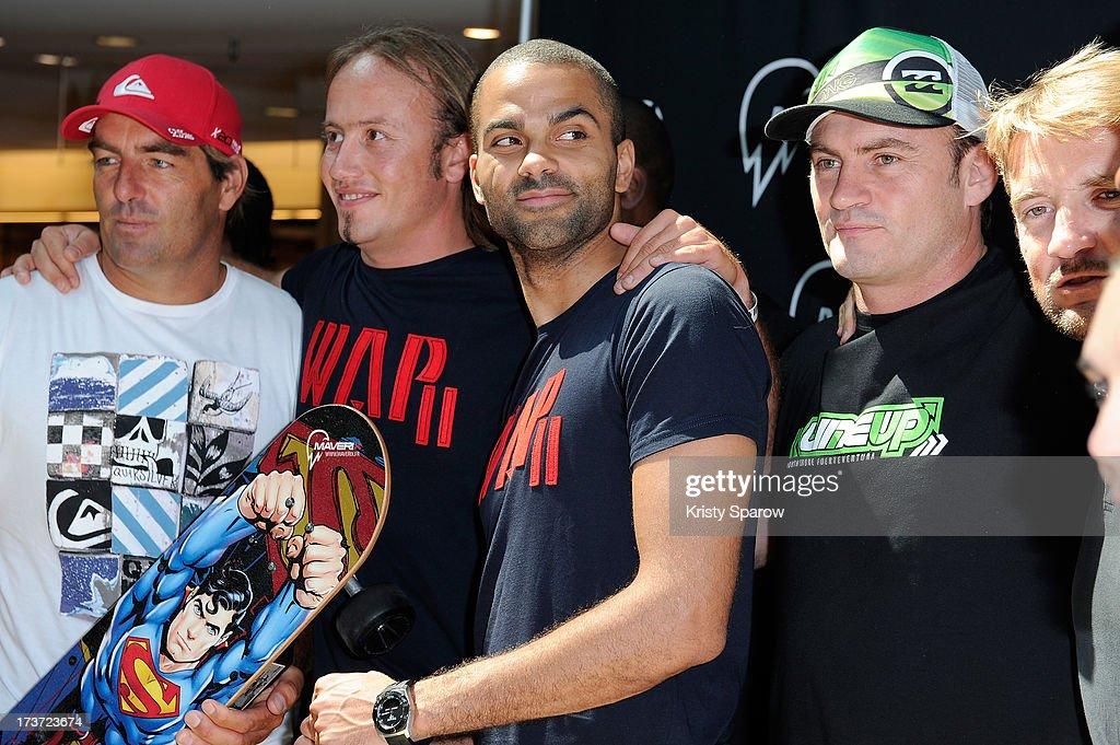 Tony Parker (C) presents Maverix Electric Skate at La Defense in Paris at La Defense on July 17, 2013 in Paris, France.