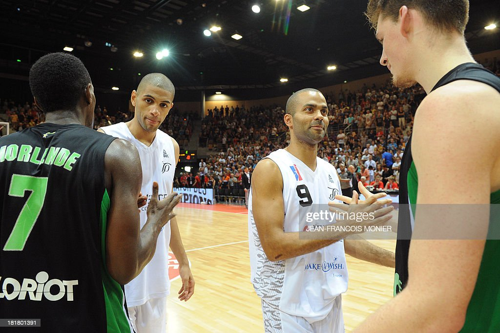 Tony Parker team's French forward Nicolas Batum (2nd L) and point guard Tony Parker (2nd R) shake hands with Lyon-Villeurbanne's French point guard Paccelis Morlende (L) and French power forward Alexandre Chassang (R) after the exibition match Tony Parker Team vs Lyon-Villeurbanne on September 25, 2013 at the Vendespace in Mouilleron-le-Captif, Western France. AFP PHOTO / JEAN-FRANCOIS MONIER