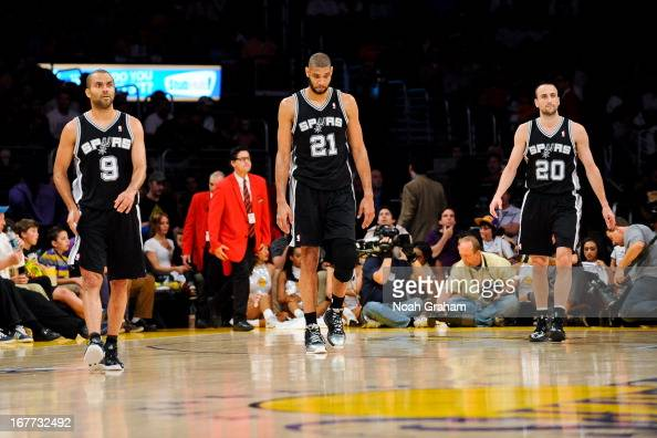 Tony Parker Tim Duncan and Manu Ginobili of the San Antonio Spurs walk on the court while playing against the Los Angeles Lakers in Game Four of the...