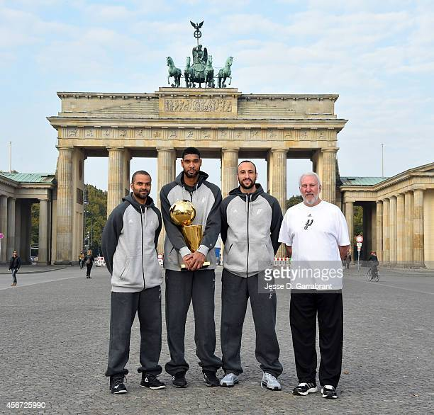Tony Parker Tim Duncan Manu Ginobili and Gregg Popovich of the San Antonio Spurs pose for a photo during the 2014 Global Games on October 6 2014 at...
