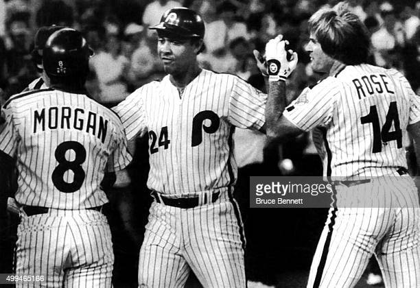 Tony Perez of the Philadelphia Phillies is congratulated by Joe Morgan and Pete Rose after hitting a threerun home run against the St Louis Cardinals...