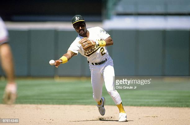 Tony Phillips of the Oakland Athletics throws during a game in the 1989 season at OaklandAlameda County Coliseum in Oakland California