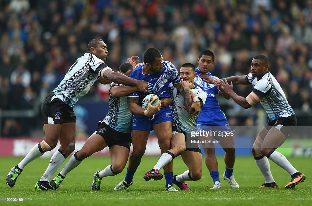 Tony Puletua of Samoa is crowded out in the tackle during the Rugby League World Cup Quarter Final match between Samoa and Fiji at The Halliwell...