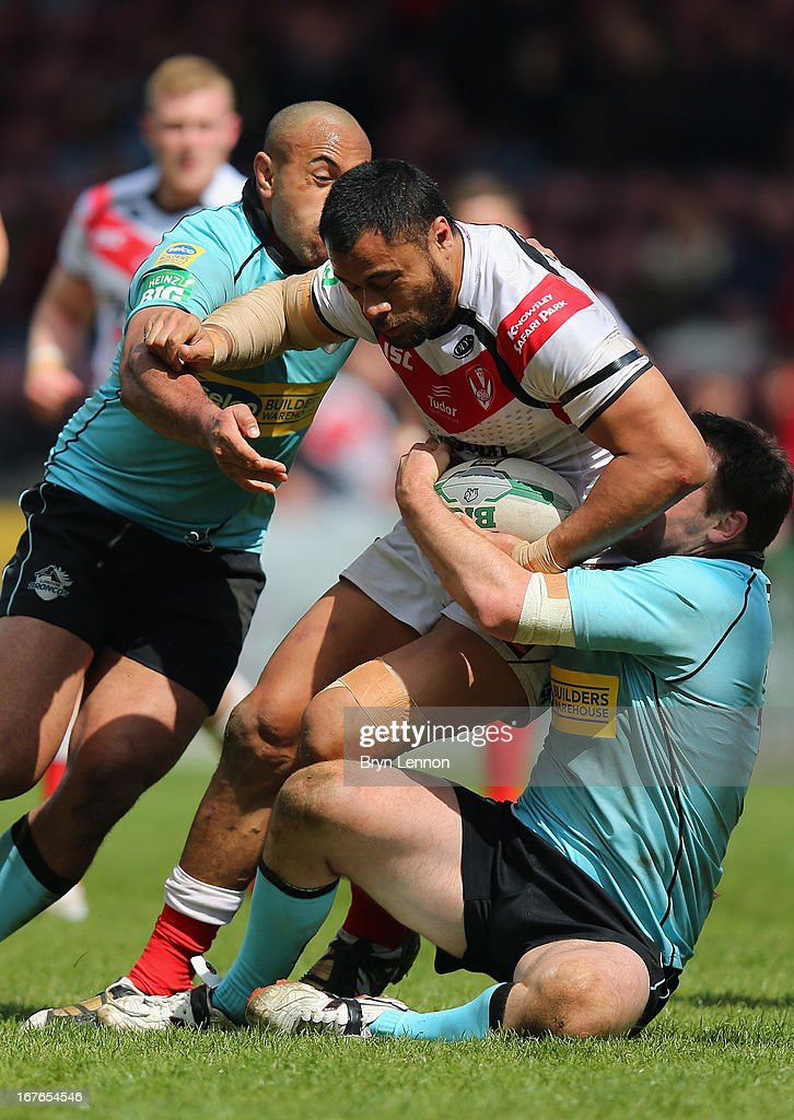Tony Puletua of St Helens is tackled by <a gi-track='captionPersonalityLinkClicked' href=/galleries/search?phrase=Michael+Robertson&family=editorial&specificpeople=234359 ng-click='$event.stopPropagation()'>Michael Robertson</a> of London Broncos during the Super League match between London Broncos and St Helens at Twickenham Stoop on April 27, 2013 in London, England.