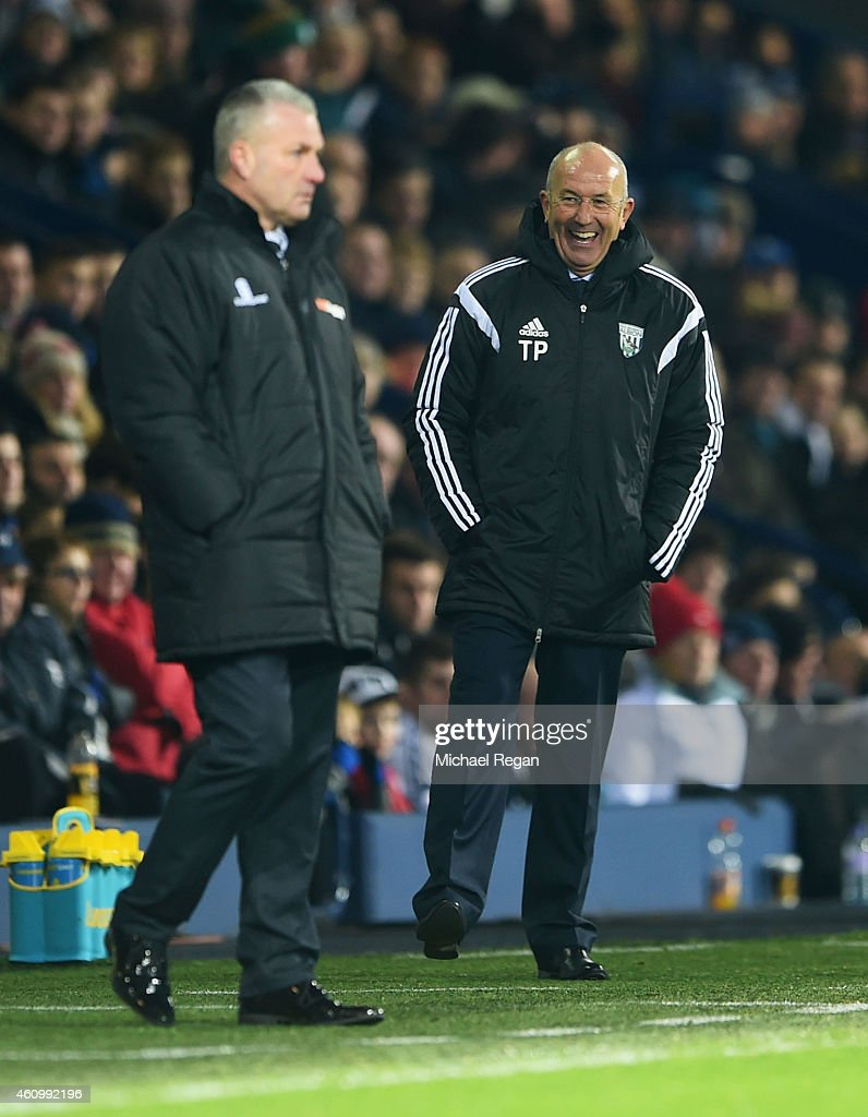 Tony Pulis head coach of West Bromwich Albion laughs as Gary Mills manager of Gateshead looks on during the FA Cup Third Round match between West...