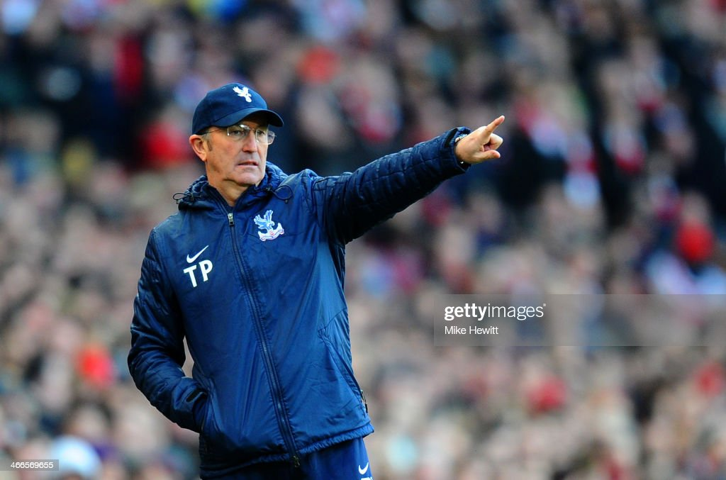 Tony Pulis manager of Crystal Palace gives instructions during the Barclays Premier League match between Arsenal and Crystal Palace at Emirates Stadium on February 2, 2014 in London, England.