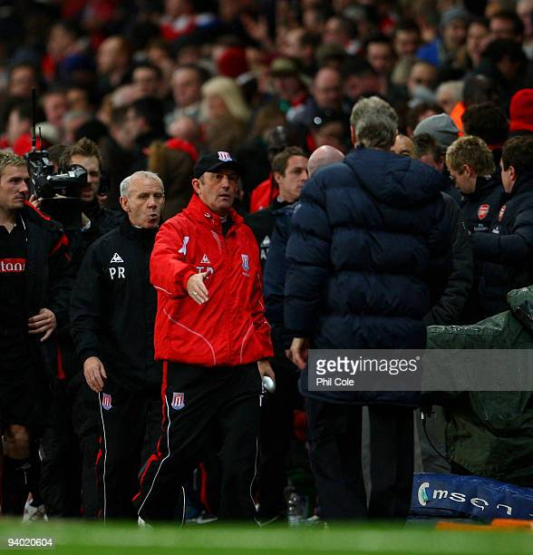 Tony Pulis manager of Stoke City shakes hands with Arsene Wenger manager of Arsenal during the Barclays Premier League match between Arsenal and...