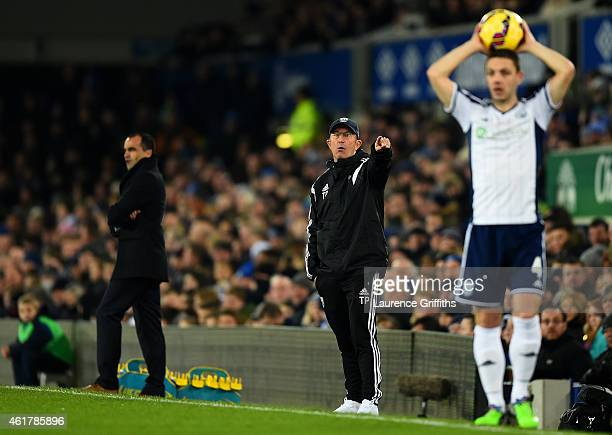 Tony Pulis manager of West Brom issues instructions to his players next to Roberto Martinez manager of Everton as Chris Baird of West Brom prepares...