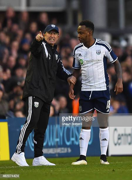 Tony Pulis manager of West Brom talks to Saido Berahino of West Brom during the FA Cup Fourth Round match between Birmingham City and West Bromwich...