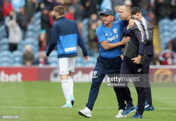 Tony Pulis Manager of West Bromwich Albion and Ian Woan Burnley assistant manager embrace after the Premier League match between Burnley and West...