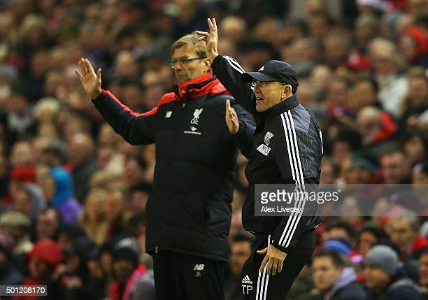 Tony Pulis manager of West Bromwich Albion and Jurgen Klopp manager of Liverpool react during the Barclays Premier League match between Liverpool and...