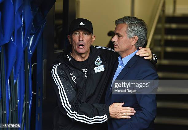 Tony Pulis manager of West Bromwich Albion greets Jose Mourinho manager of Chelsea prior to the Barclays Premier League match between West Bromwich...