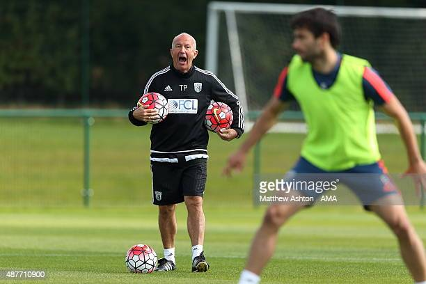 Tony Pulis the head coach / manager of West Bromwich Albion talks to his players during the training session during the West Bromwich Albion training...