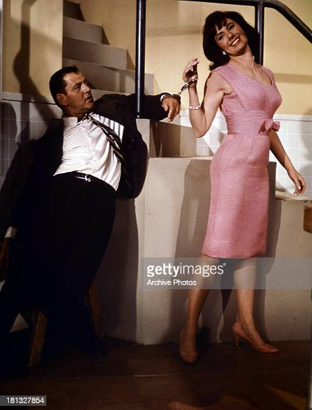 Tony Randall is handcuffed to Shirley Jones in a scene from the film 'Fluffy' 1965