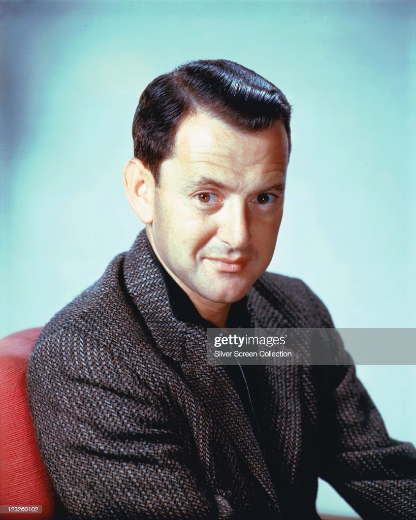 <a gi-track='captionPersonalityLinkClicked' href=/galleries/search?phrase=Tony+Randall+-+Actor&family=editorial&specificpeople=167042 ng-click='$event.stopPropagation()'>Tony Randall</a> (1920-2004), US actor and comedian, wearing a grey tweed jacket, in a studio portrait, against a light blue background, issued as publicity for the US television series, 'The Odd Couple', circa 1973. The sitcom, based on characters from the play by Neil Simon, starred Randall as 'Felix Unger'.