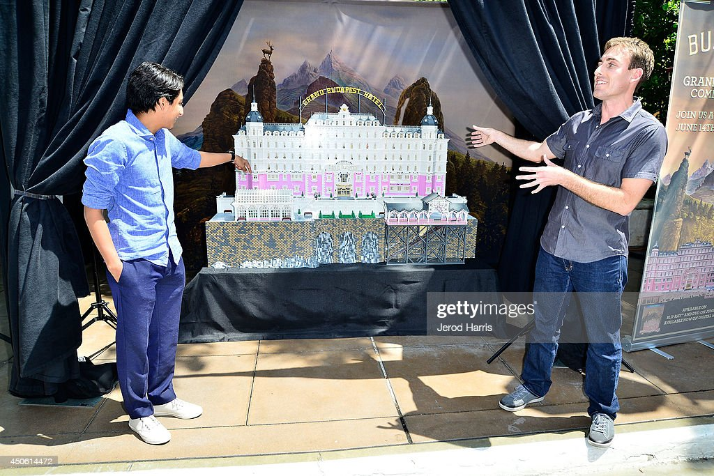 Tony Revolori and Lego builder Ryan Ziegelbauer attend the Unveiling of 'Grand Budapest Hotel' Made of 50,000 Lego bricks in celebration of the DVD/Blu-Ray release at The Grove on June 14, 2014 in Los Angeles, California.