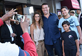 Tony Robbins takes photos with fans at the celebration of the release of Joe Berlinger / Tony Robbins documentary 'I Am Not Your Guru' now available...