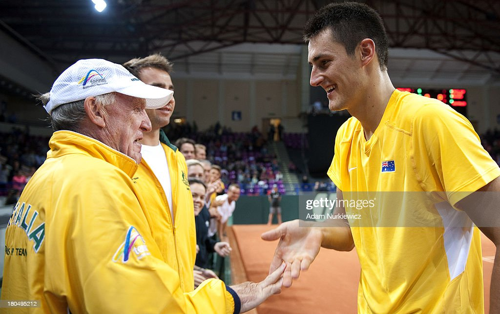 Tony Roche (L), coach and Bernard Tomic of Australia after winning the second match during the Davis Cup match between Poland and Australia at the Torwar Hall, on September 13, 2013 in Warsaw, England.