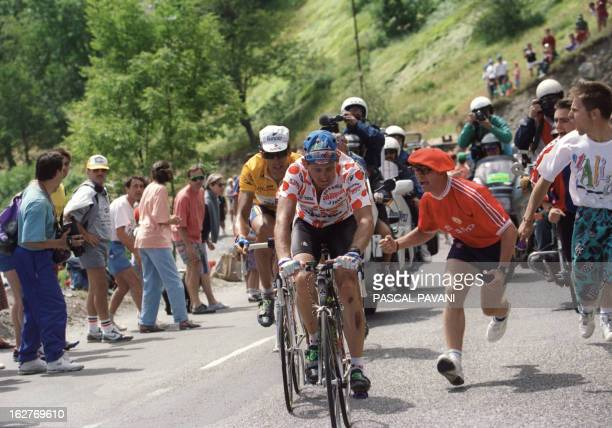 Tony Rominger from Switzerland wearing the red and white Polka Dot Jersey of the best climber is followed by Spaniard Miguel Indurain wearing Yellow...