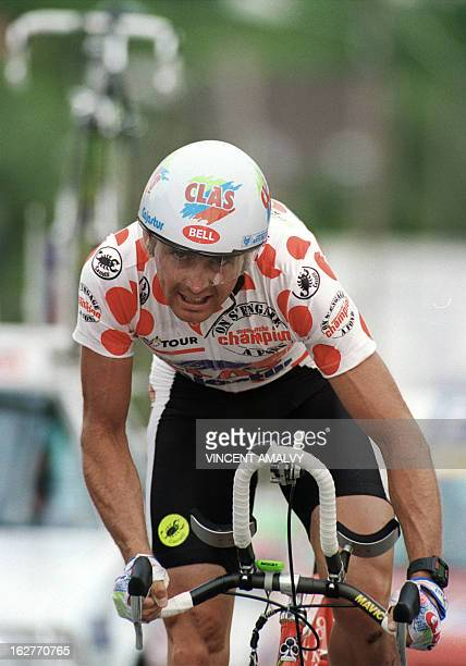 Tony Rominger from Switzerland wearing the red and white Polka Dot Jersey of the best climber makes his efforts 24 July 1993 during the 19th and...
