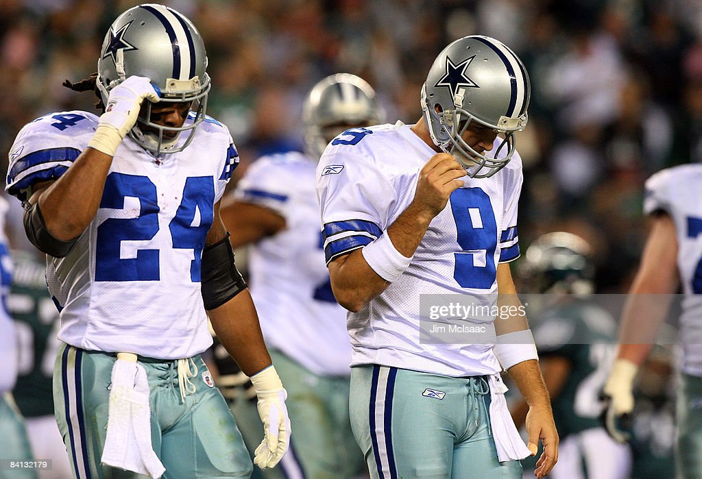 Tony Romo and Marion Barber of the Dallas Cowboys walk to the bench after losing possesion of the ball in the second half against the Philadelphia...