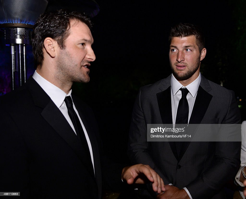 <a gi-track='captionPersonalityLinkClicked' href=/galleries/search?phrase=Tony+Romo&family=editorial&specificpeople=756503 ng-click='$event.stopPropagation()'>Tony Romo</a> (L) and <a gi-track='captionPersonalityLinkClicked' href=/galleries/search?phrase=Tim+Tebow&family=editorial&specificpeople=2729658 ng-click='$event.stopPropagation()'>Tim Tebow</a> attend the Bloomberg & Vanity Fair cocktail reception following the 2014 WHCA Dinner at Villa Firenze on May 3, 2014 in Washington, DC.