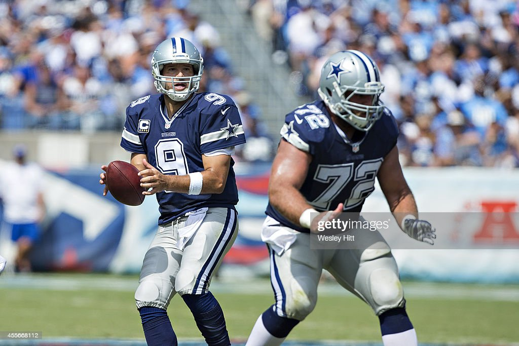 <a gi-track='captionPersonalityLinkClicked' href=/galleries/search?phrase=Tony+Romo&family=editorial&specificpeople=756503 ng-click='$event.stopPropagation()'>Tony Romo</a> #9 drops back to pass behind the blocking of <a gi-track='captionPersonalityLinkClicked' href=/galleries/search?phrase=Travis+Frederick&family=editorial&specificpeople=6243538 ng-click='$event.stopPropagation()'>Travis Frederick</a> #72 of the Dallas Cowboys during a game against the Tennessee Titans at LP Field on September 14, 2014 in Nashville, Tennessee. The Cowboys defeated the Titans 26-10.