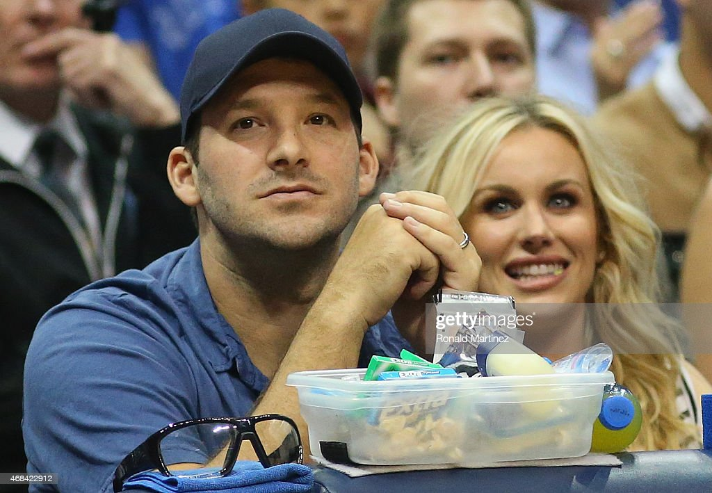 <a gi-track='captionPersonalityLinkClicked' href=/galleries/search?phrase=Tony+Romo&family=editorial&specificpeople=756503 ng-click='$event.stopPropagation()'>Tony Romo</a> of the Dallas Cowboys and <a gi-track='captionPersonalityLinkClicked' href=/galleries/search?phrase=Candice+Crawford&family=editorial&specificpeople=5127745 ng-click='$event.stopPropagation()'>Candice Crawford</a> watch a game between the Dallas Mavericks and the Houston Rockets at American Airlines Center on April 2, 2015 in Dallas, Texas.