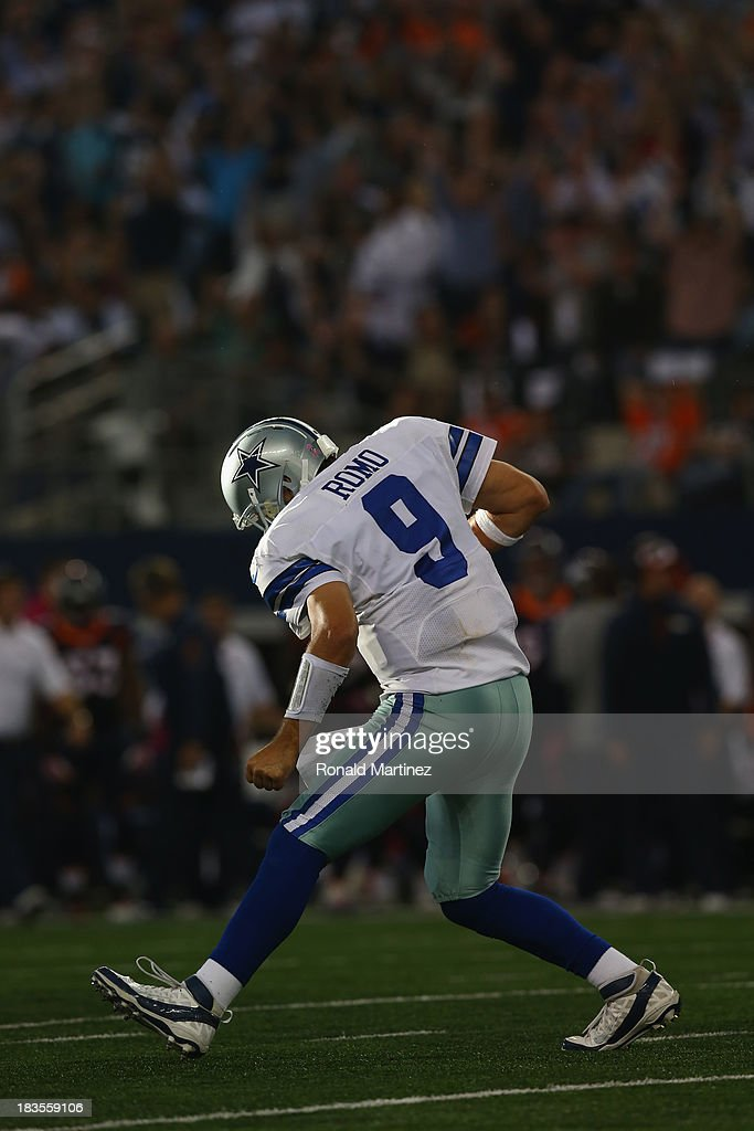 <a gi-track='captionPersonalityLinkClicked' href=/galleries/search?phrase=Tony+Romo&family=editorial&specificpeople=756503 ng-click='$event.stopPropagation()'>Tony Romo</a> #9 of the Dallas Cowboys celebrates a touchdown against the Denver Broncos at AT&T Stadium on October 6, 2013 in Arlington, Texas.