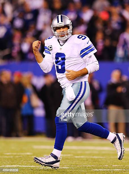 Tony Romo of the Dallas Cowboys celebrates throwing the game winning touchdown pass in the fourth quarter against the New York Giants at MetLife...