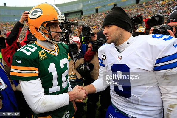 Tony Romo of the Dallas Cowboys congratulates Aaron Rodgers of the Green Bay Packers after the 2015 NFC Divisional Playoff game at Lambeau Field on...