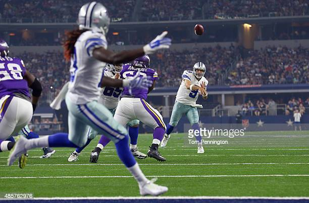 Tony Romo of the Dallas Cowboys connects a touchdown pass to Lucky Whitehead of the Dallas Cowboys to score against the Minnesota Vikings in the...