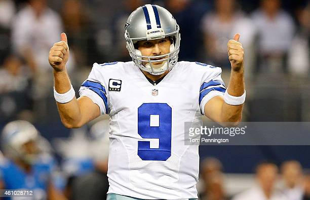 Tony Romo of the Dallas Cowboys gestures against the Detroit Lions during the second half of their NFC Wild Card Playoff game at ATT Stadium on...