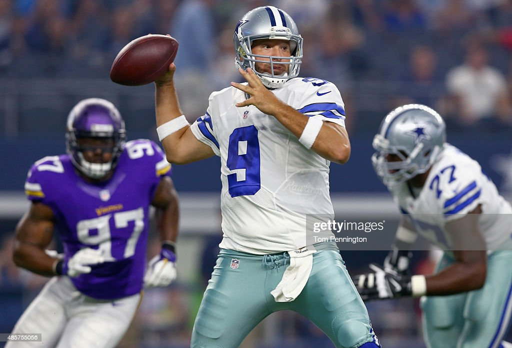 Tony Romo #9 of the Dallas Cowboys looks for an open receiver under pressure from Everson Griffen #97 of the Minnesota Vikings in the first quarter on August 29, 2015 in Arlington, Texas.