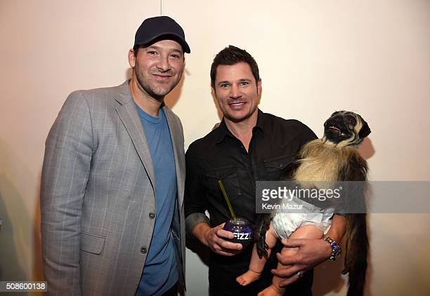Tony Romo of the Dallas Cowboys Nick Lachey and Puppy Monkey Baby visit the SiriusXM set at Super Bowl 50 Radio Row at the Moscone Center on February...