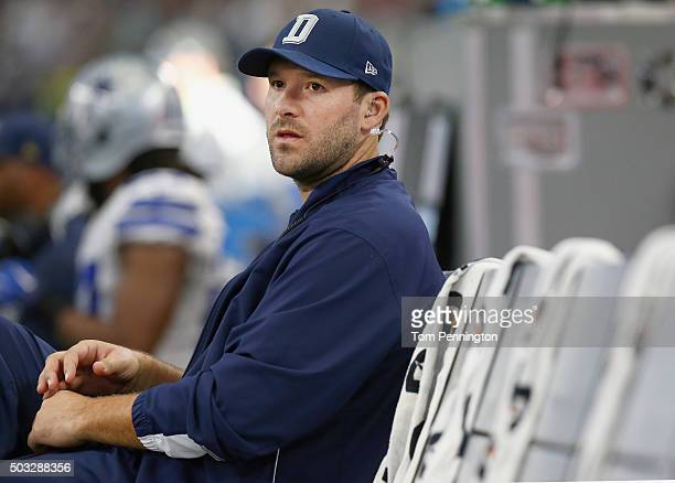 Tony Romo of the Dallas Cowboys sits on the bench late in the fourth quarter as the Washington Redskins beat the Dallas Cowboys 3423 at ATT Stadium...
