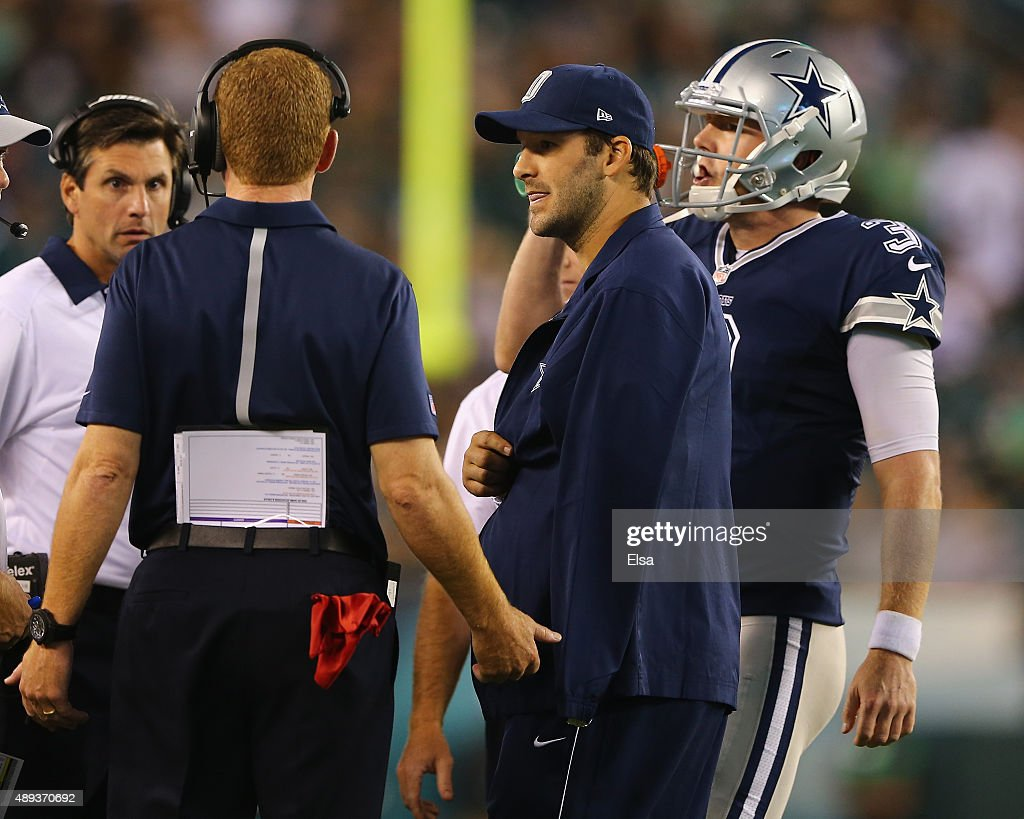 <a gi-track='captionPersonalityLinkClicked' href=/galleries/search?phrase=Tony+Romo&family=editorial&specificpeople=756503 ng-click='$event.stopPropagation()'>Tony Romo</a> #9 of the Dallas Cowboys talks with head coach <a gi-track='captionPersonalityLinkClicked' href=/galleries/search?phrase=Jason+Garrett&family=editorial&specificpeople=965512 ng-click='$event.stopPropagation()'>Jason Garrett</a> and quarterback <a gi-track='captionPersonalityLinkClicked' href=/galleries/search?phrase=Brandon+Weeden&family=editorial&specificpeople=7125737 ng-click='$event.stopPropagation()'>Brandon Weeden</a> #3 in the fourth quarter against the Philadelphia Eagles on September 20, 2014 at Lincoln Financial Field in Philadelphia, Pennsylvania.The Dallas Cowboys defeated the Philadelphia Eagles 20-10. Romo was injured in the third quarter and did not return to the game.