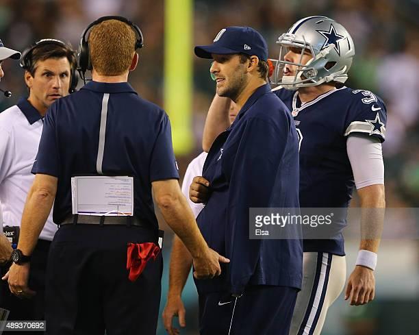 Tony Romo of the Dallas Cowboys talks with head coach Jason Garrett and quarterback Brandon Weeden in the fourth quarter against the Philadelphia...