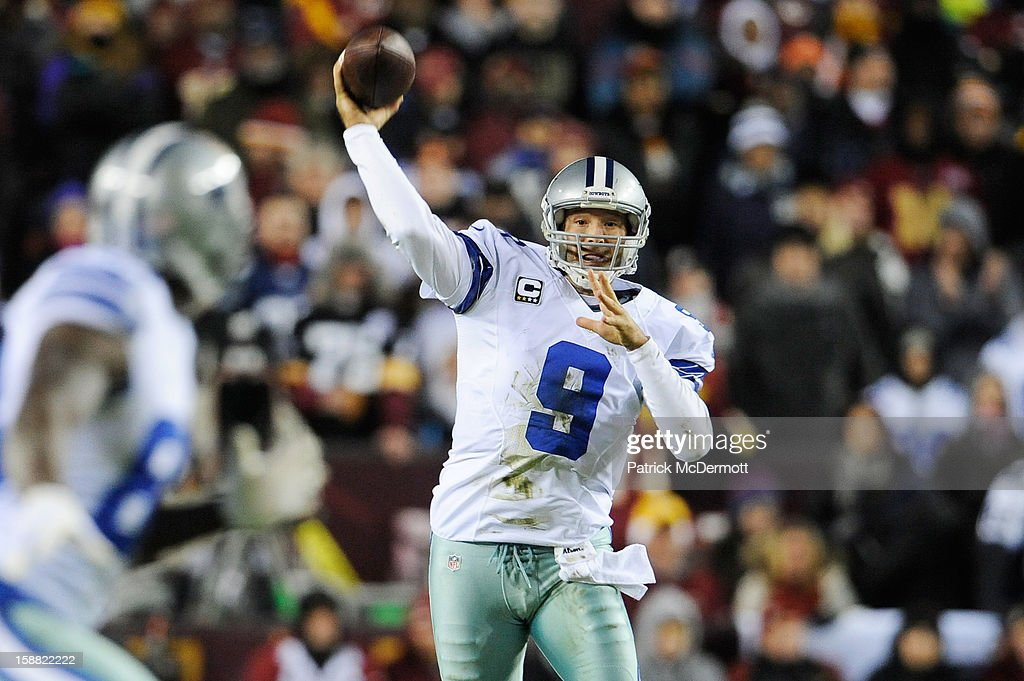 Tony Romo #9 of the Dallas Cowboys throws a first down pass in the second quarter against the Washington Redskins at FedExField on December 30, 2012 in Landover, Maryland.