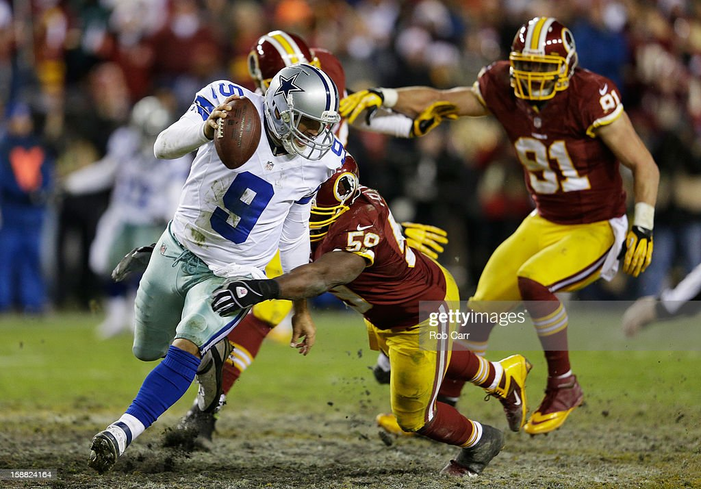 Tony Romo #9 of the Dallas Cowboys tries to avoid the tackle of London Fletcher #59 of the Washington Redskins in the fourth quarter at FedExField on December 30, 2012 in Landover, Maryland.