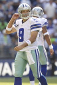 Tony Romo of the Dallas Cowboys walks off the field after failing to convert third down during play against the Seattle Seahawks at CenturyLink Field...