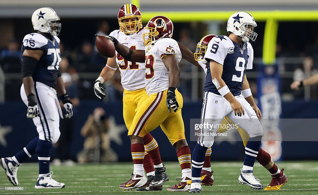 <a gi-track='captionPersonalityLinkClicked' href=/galleries/search?phrase=Tony+Romo&family=editorial&specificpeople=756503 ng-click='$event.stopPropagation()'>Tony Romo</a> #9 of the Dallas Cowboys walks off the field after throwing a pass reception to <a gi-track='captionPersonalityLinkClicked' href=/galleries/search?phrase=London+Fletcher&family=editorial&specificpeople=223941 ng-click='$event.stopPropagation()'>London Fletcher</a> #59 of the Washington Redskins during the Thanksgiving Day game at Cowboys Stadium on November 22, 2012 in Arlington, Texas.