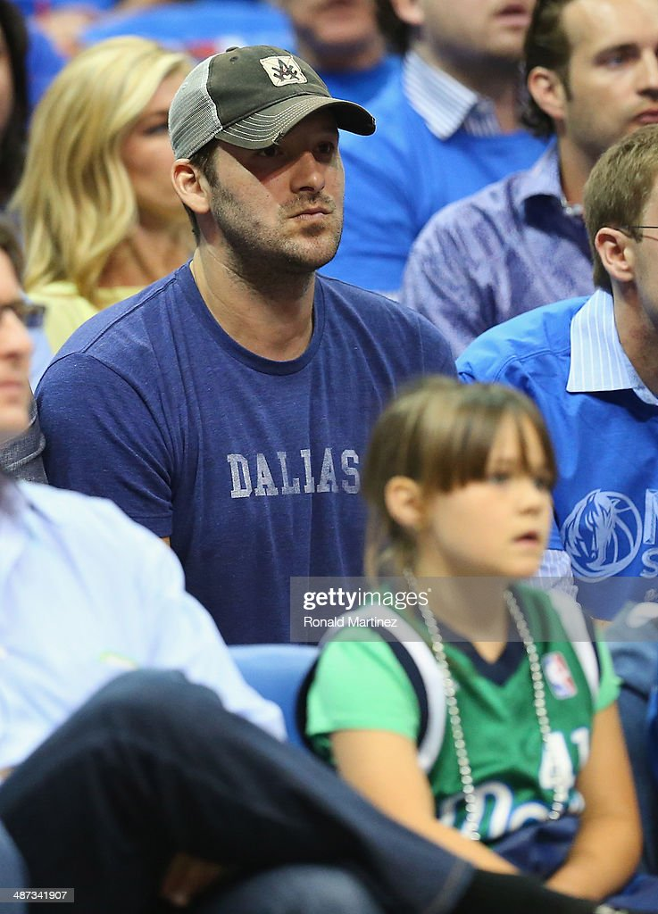 Tony Romo of the Dallas Cowboys watches a game between the San Antonio Spurs and the Dallas Mavericks in Game Four of the Western Conference Quarterfinals during the 2014 NBA Playoffs at American Airlines Center on April 28, 2014 in Dallas, Texas.
