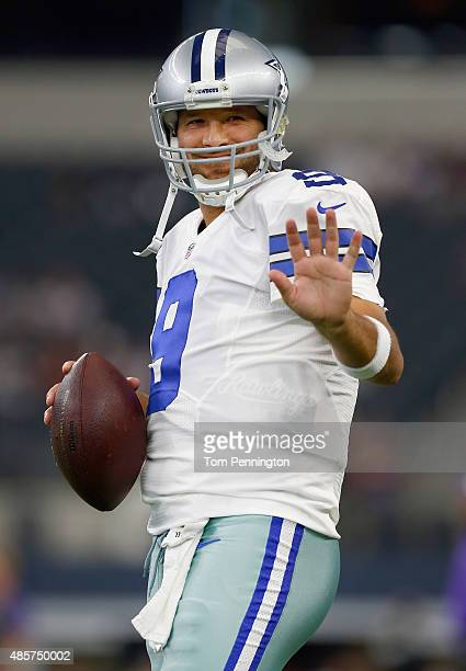 Tony Romo of the Dallas Cowboys waves to his son on the sidelines before the Cowboys take on the Minnesota Vikings on August 29 2015 in Arlington...