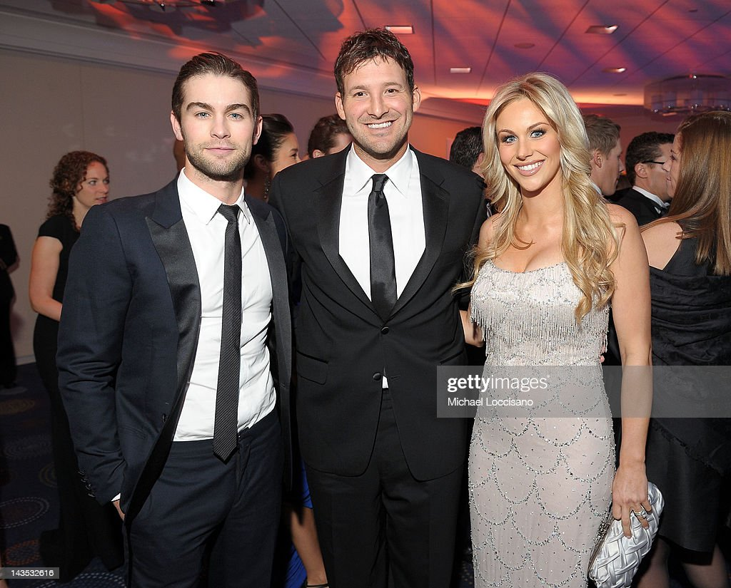 <a gi-track='captionPersonalityLinkClicked' href=/galleries/search?phrase=Tony+Romo&family=editorial&specificpeople=756503 ng-click='$event.stopPropagation()'>Tony Romo</a> ( C) poses with <a gi-track='captionPersonalityLinkClicked' href=/galleries/search?phrase=Candice+Crawford&family=editorial&specificpeople=5127745 ng-click='$event.stopPropagation()'>Candice Crawford</a> (R) and <a gi-track='captionPersonalityLinkClicked' href=/galleries/search?phrase=Chace+Crawford&family=editorial&specificpeople=4238517 ng-click='$event.stopPropagation()'>Chace Crawford</a> (L) at the TIME/PEOPLE/FORTUNE/CNN White House Correspondents' Association Dinner Cocktail Party at the Hilton Hotel on April 28, 2012 in Washington, DC.