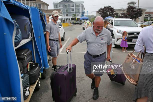 Tony Rossi who was a nightclub owner and also had a rental business helps with the luggage at the parking lot at the Hyline Ferry parking department...